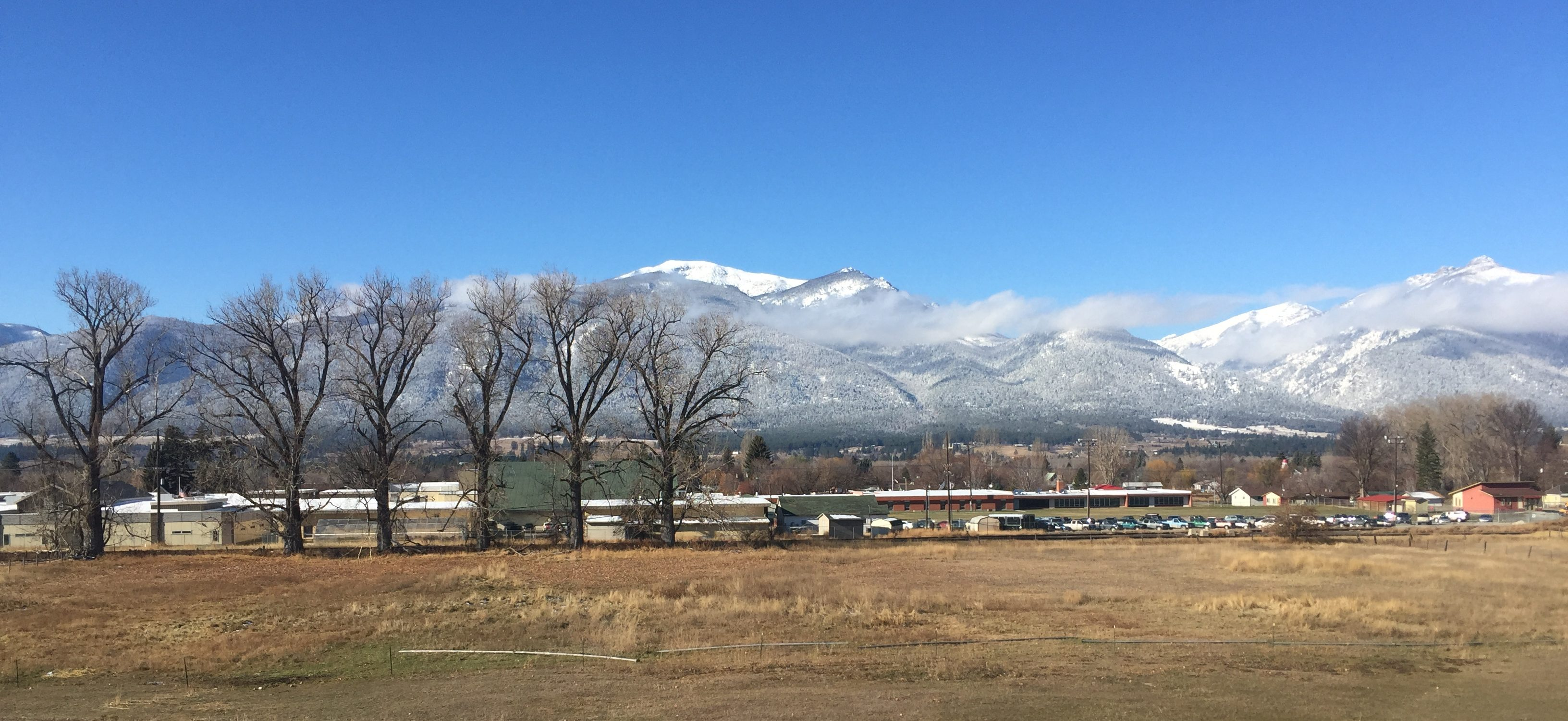 Photo of Stevensville Schools with St. Mary Peak in the background, taken from the High School Football stadium.